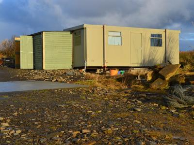 Linked twin 20' x 10' cabins with external store